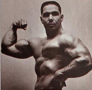 bill pearl biceps pose